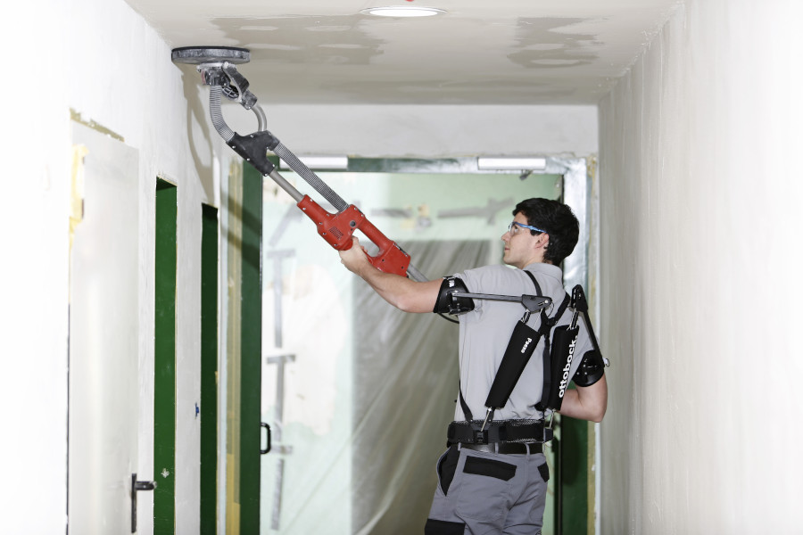 Paexo Shoulder exoskeleton being used to sand a ceiling.